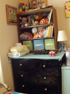 Bookshelf gives some decorative, but out of reach storage on top of the dresser.